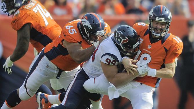 Peyton Manning, J.J. Watt, Manny Ramirez, futebol americano (AP Photo/Jack Dempsey, File)