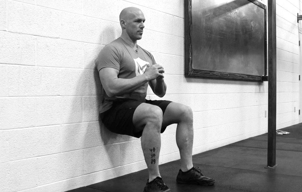 fortalecer tendão exercícios wall sits